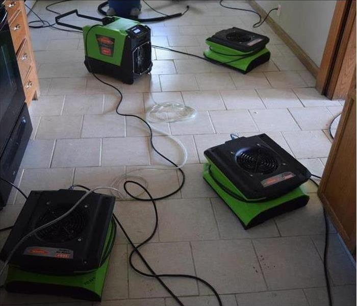 Air movers drying floor