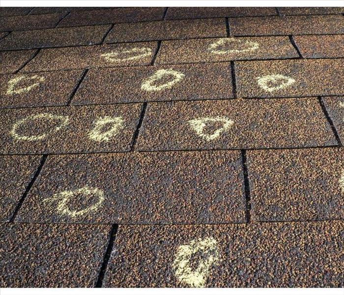 Marked hail damage on the roof of an insured party.