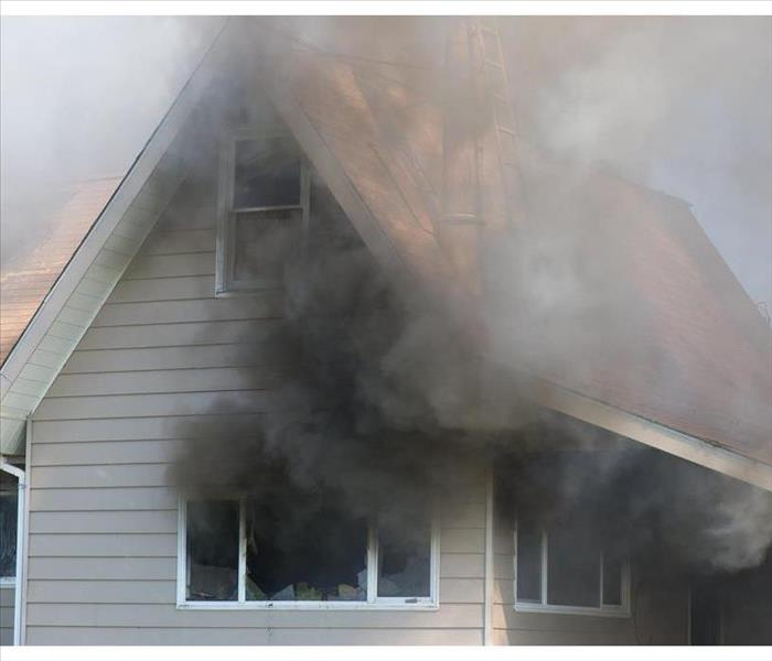 Black smoke coming out of a house